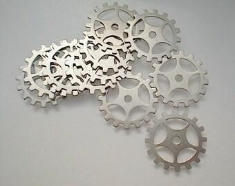 12 medium nickel silver gear/sprocket charms/stampings