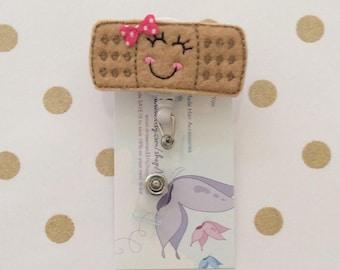 Bandaid reel badge- band-aid reel badge- pediatric nurse reel badge-pediatric reel badge- emt reel badge- er reel badge-cna reel badge
