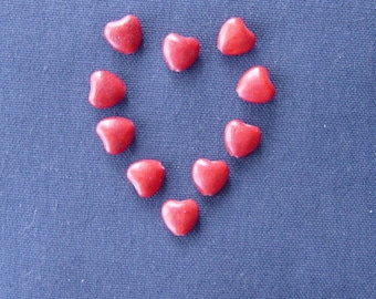 10 red heart shaped beads