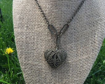 Dark gold heart shaped pendant necklace