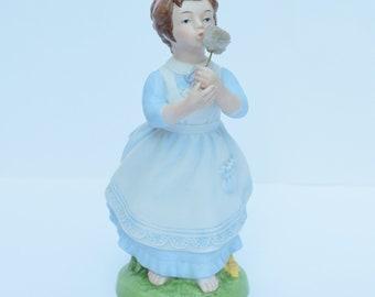 "Avon ""Wishful Thoughts"" Porcelain figurine"