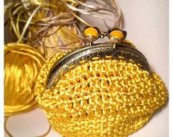 small yellow crochet handmade purse and flowers