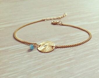 Bracelet chain with a golden tassel