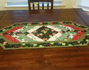 Christmas Tree Skirt.  Black Christmas Border 45 inches long and 18 inches wide.