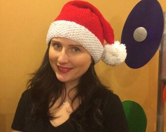 Santa baby hand knit hat pom pom