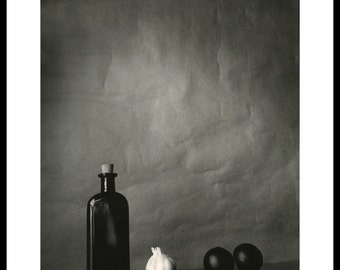 still life with garlic and plums.Silver gelatin print 8x10 in.