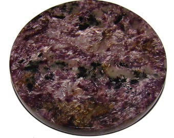 Natural Charoite disk for healing or for home decor. Far East, Yakutia, Russia