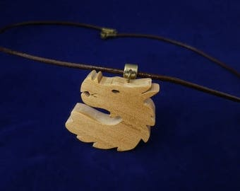 cherry wood and brown leather dragon pendant