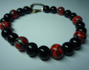Red black bracelet made of polymer clay