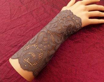 pair of fingerless gloves arm warmers in grey lace