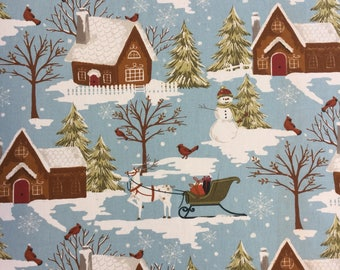 Edinburgh Weavers Gingerbread House Christmas cotton print fabric by the metre