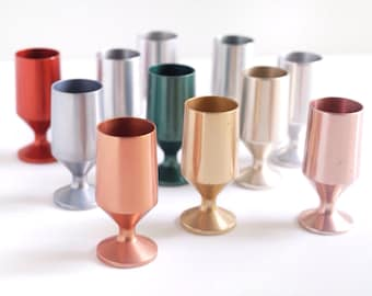 11 anodized aluminum cordial or shot glasses, vintage 1950s or 1960s barware, multicolored mid century stemmed liqueur glasses, jewel tones