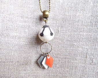 Necklace with bead sequins and ivory raku orange white and gray