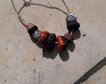 set of 7 ceramic raku red, black and white beads