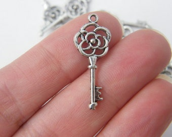 10 Key charms antique silver tone K10