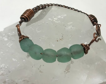 African recycled glass bead bracelet with copper viking knit band and goose neck clasp.