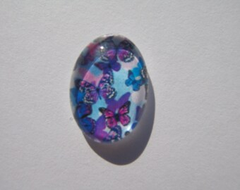 Oval glass cabochon 13 X 18 mm with a purple butterfly image