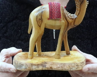 Small Olive wood hand made Camel on olive wood base made by the seller