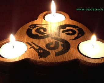 Candle holders/incense burners with triskel