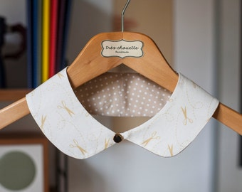 Cotton Peter Pan collar with  gold plated button closure, featuring a sewing inspired pattern.