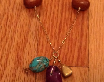 Long BOHO mixed media necklace. Wood beads on gold chain. Cute Charms