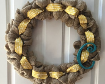 burlap wreath with yellow aarow ribbon and letter