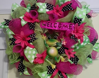 This bright and colorful frog wreath will look good at your pad.