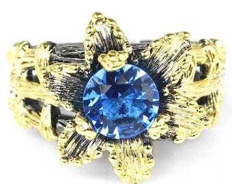RINGS:  Stunning Blue Topaz Black Gold Ring with Brushed Gold