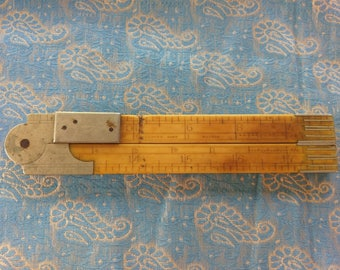 J Rabone & sons makers folding bone and Silver ruler 24""