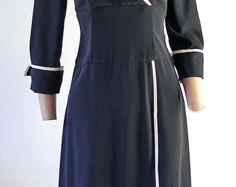 Classic vintage black dress trimmed in white satin.  Size 4
