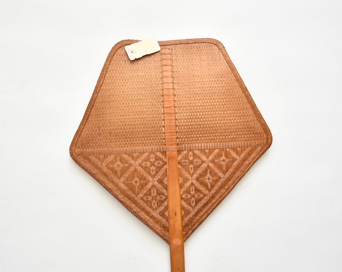 1970s brown geometric shaped delicate woven rattan fan / wall basket