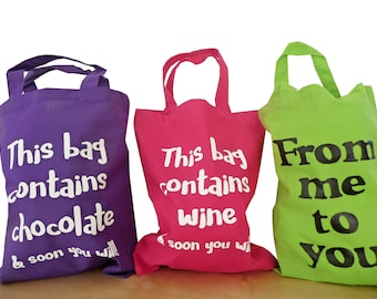 Medium Cotton gift bags. Various slogans/colours.