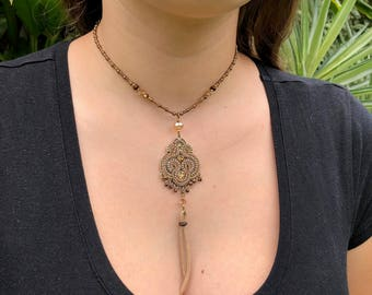 Earthy colored embellished crystal pendant necklace