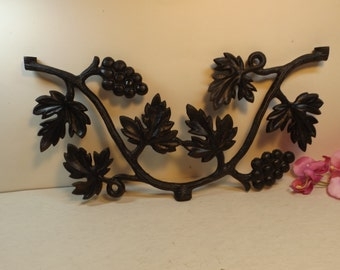 Cast iron grape motif. It may be used as a wall decor or as a part of your project. Home decor. Garden decor.Project. Cast iron grape branch