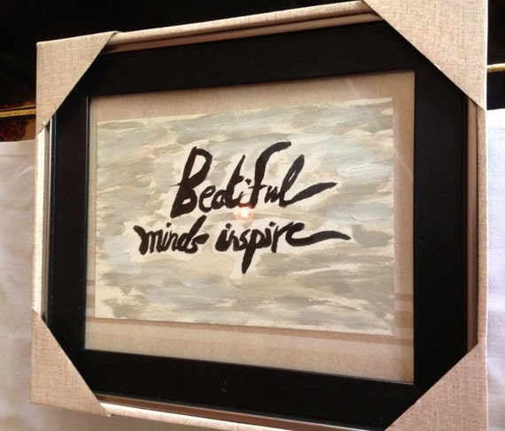 calligraphy ,black brush with light .dark  beige and grey painting background on paper .with wooden dark brown frame