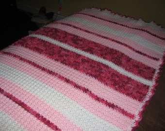 Pink and white crochet afghan