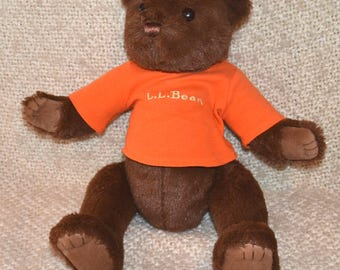 """BEAR by MARY MEYER Vintage 80s..with Orange Shirt that says """" L.L.Bean """"  Dark Brown Fuzzy Plush Bear.Tan Suede on Paws & Feet. Glass Eyes."""