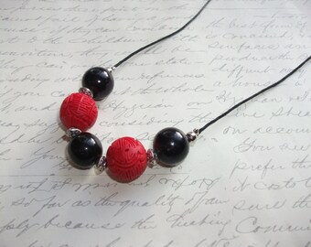 Black and red cinnabar necklace