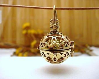 Harmony ball brass pendant.
