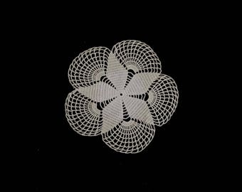 Vintage handmade small crocheted doily -- beige crocheted doily with a flower center and large fan-shaped scallops -- 7.5 inches / 19 cm