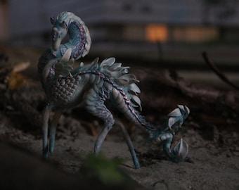 blue creature kirin unicorn figurine