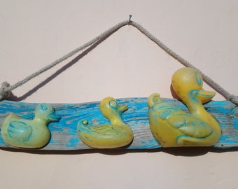 Driftwood hand painted sign, with rubber ducks (found on the beach)