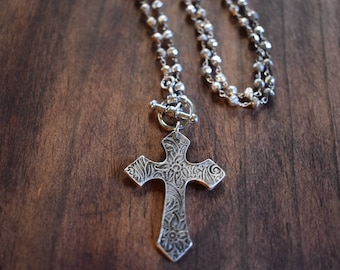 Fine silver cross on a sterling silver rosary style pyrite chain