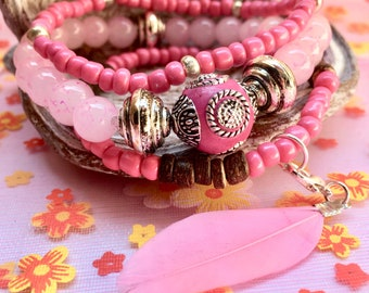 Beaded bracelet in color pink with charm