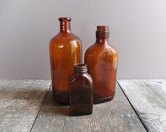 Vintage Brown Glass Bottle Collection - Set of 3