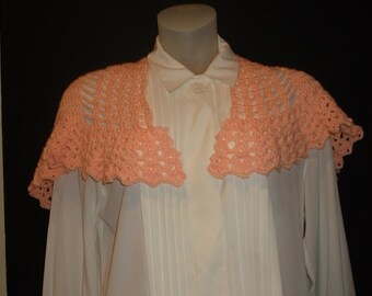 A crochet peach shawl. Crocheted of lighter weight yarn. Depending on your area or weather preference  the shawl can be worn all year. It re