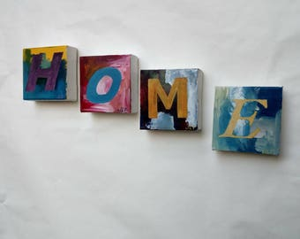 """Four small letter paintings that spell """"HOME"""". Original Acrylic paintings on canvas by JLF."""