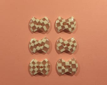 Vintage set of 1960's perspex bow shaped buttons.