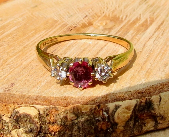 Vintage ruby and diamond trilogy 9k yellow gold ring.