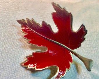 Vintage red enamel on metal maple leaf brooch pin.